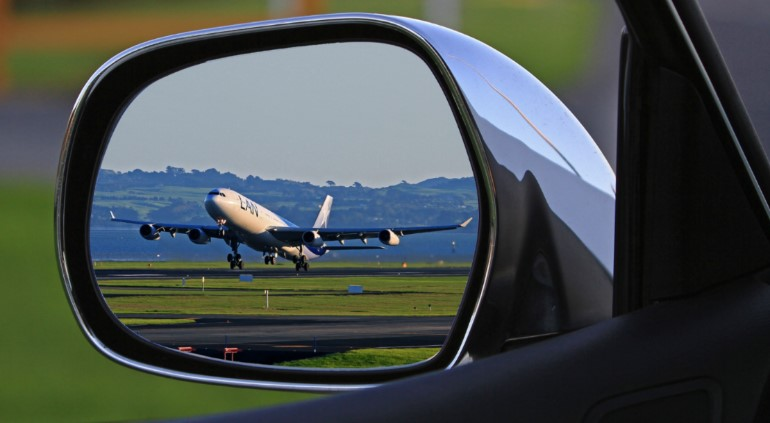 Plane in a rear view mirror